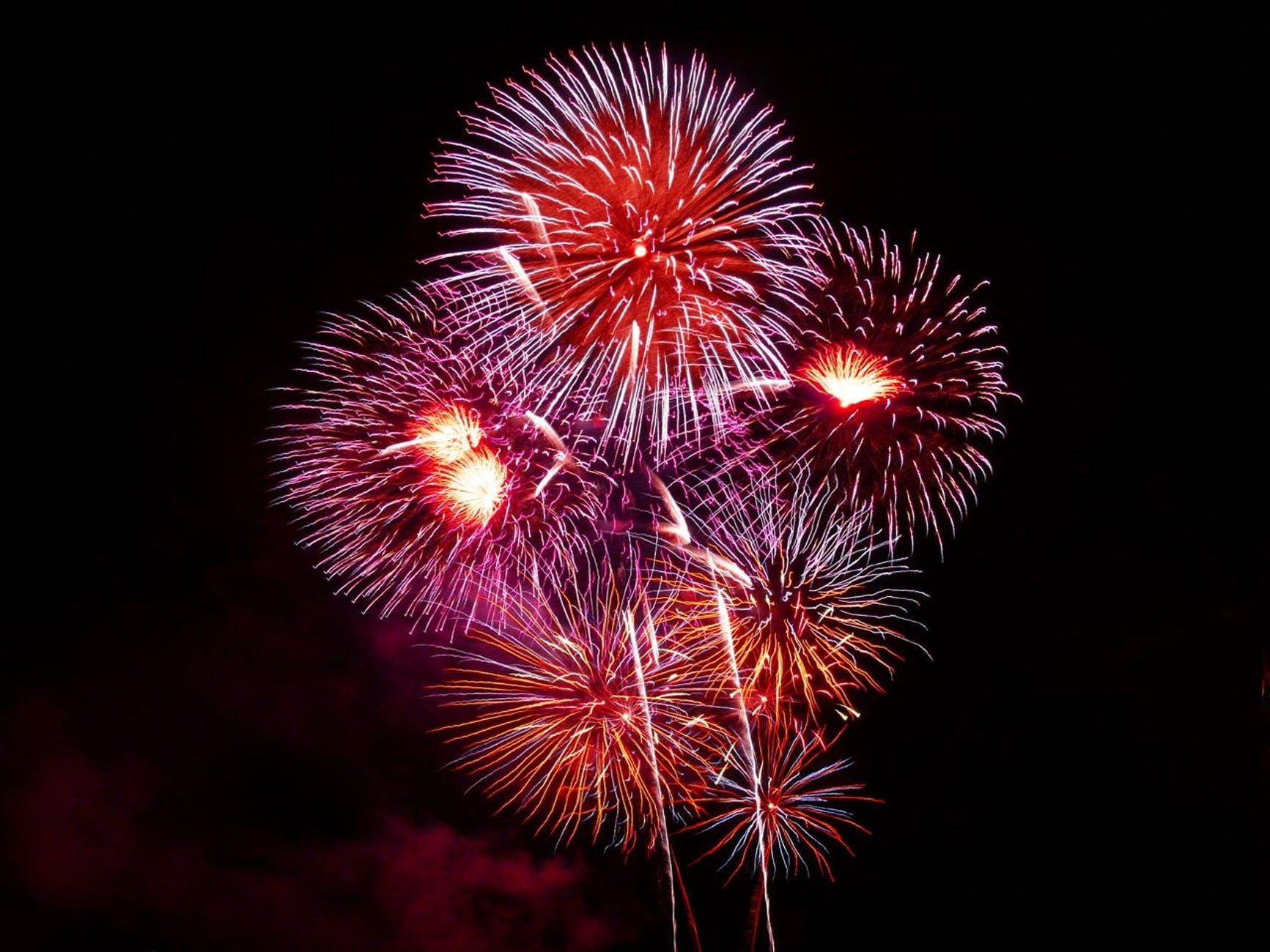 purple red white and orange fireworks display