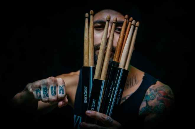 man holding drum sticks