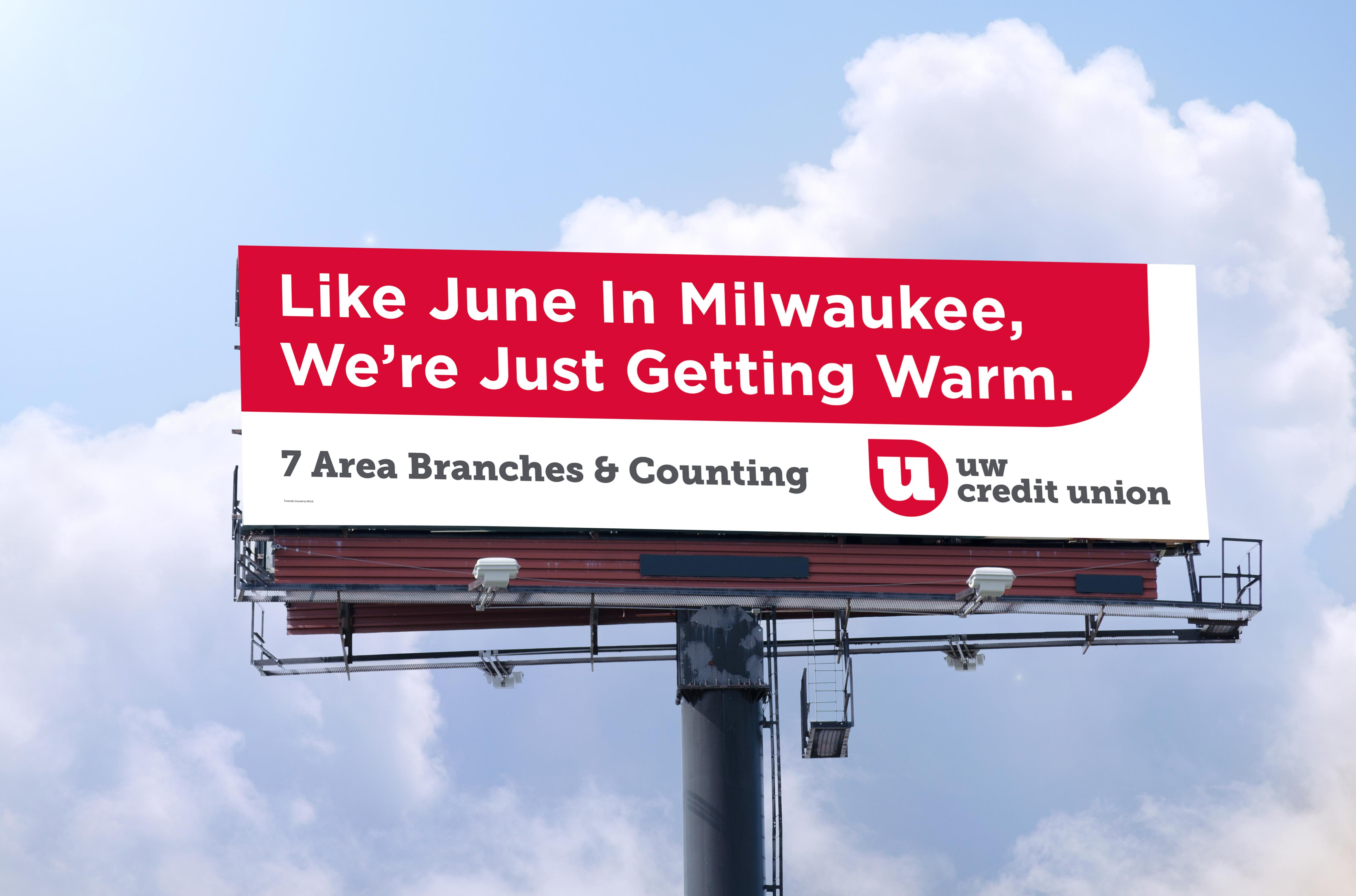 Blank roadside billboard on bright sunny blue sky day
